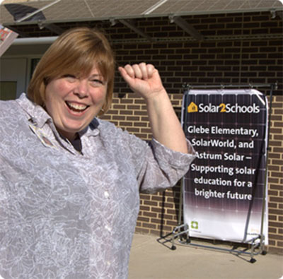 Glebe Elementary Principal, Jamie Borg, celebrating the first SolarWorld Solar2Schools installation