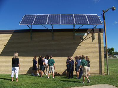 The solar panels on this schools are always visible to the students.